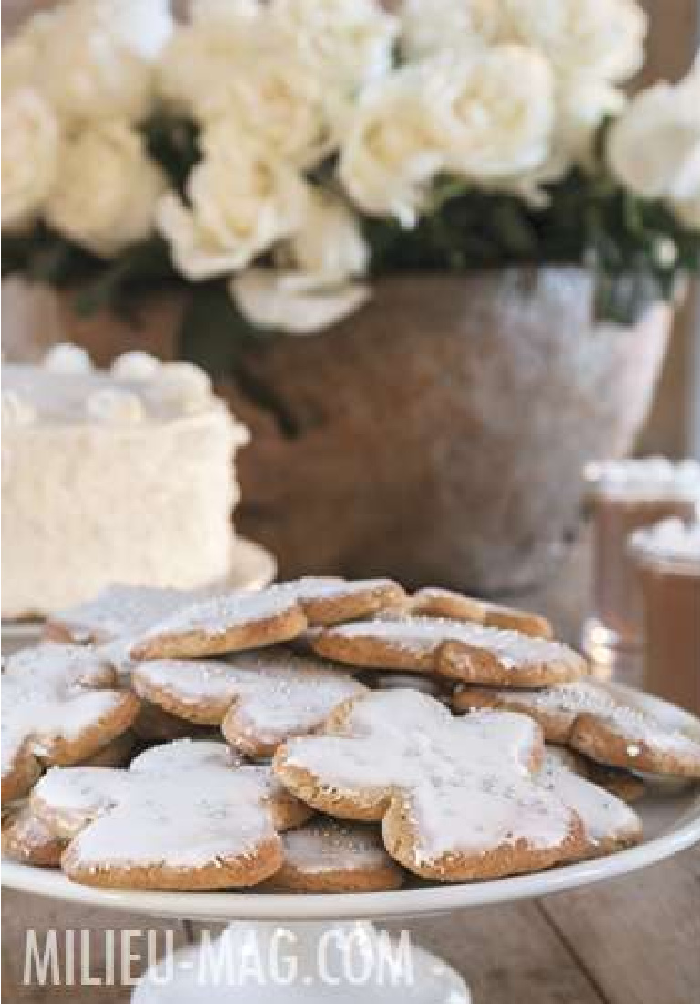 Angel cookies with white icing in Pamela Pierce's Houston home decorated for Christmas - Milieu magazine. #whitechristmas #christmascookies #frenchcountry #whitechristmas #pamelapierce