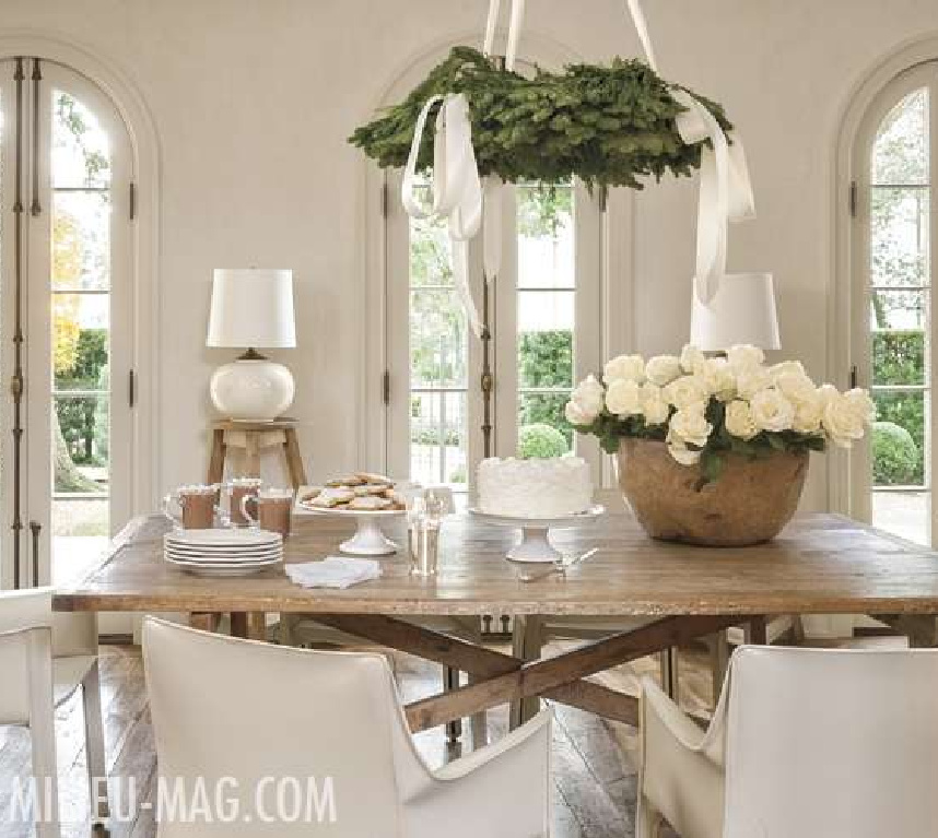 White Christmas decor in a modern French dining room with white roses and fresh greenery - Pamela Pierce for Milieu magazine. #christmasdecor #frenchcountry #elegantchristmasdecor