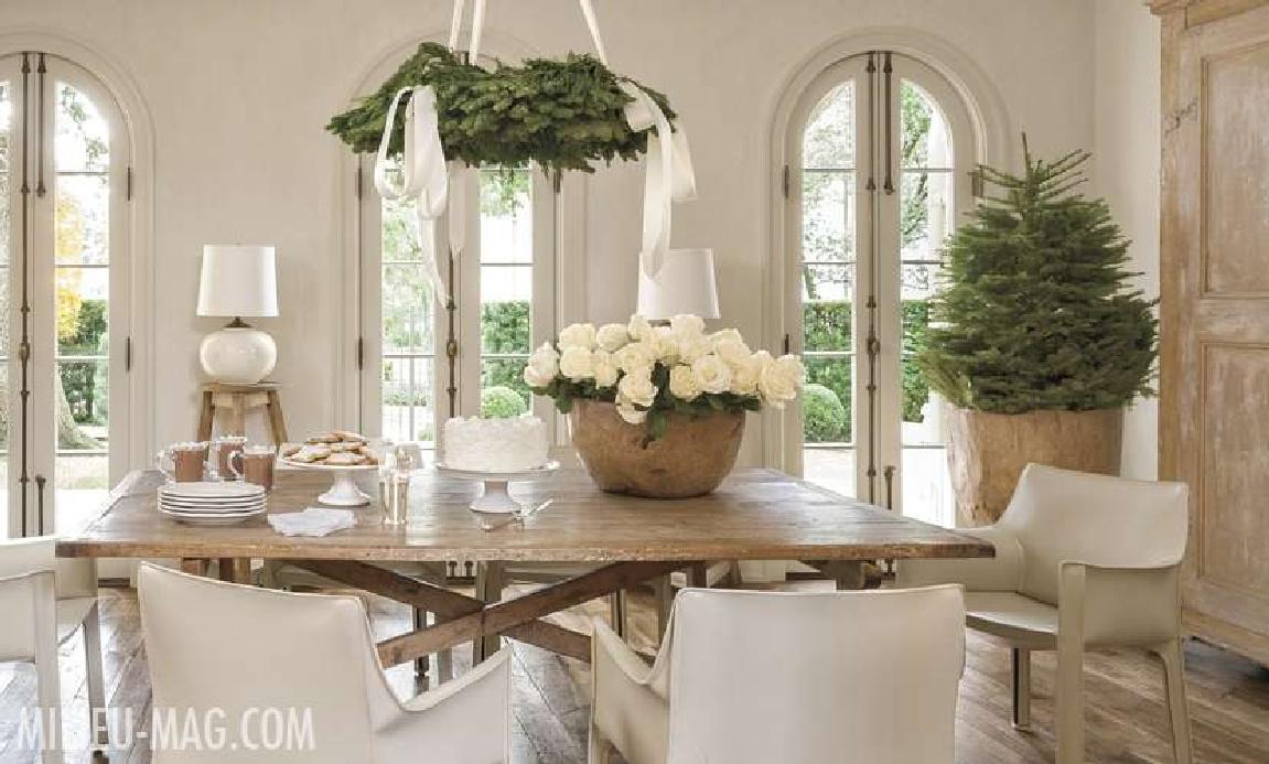 White Christmas decor in a modern French dining room with white roses and fresh greenery - Pamela Pierce for Milieu magazine. #christmasdecor #frenchcountry #elegantchristmasdecor