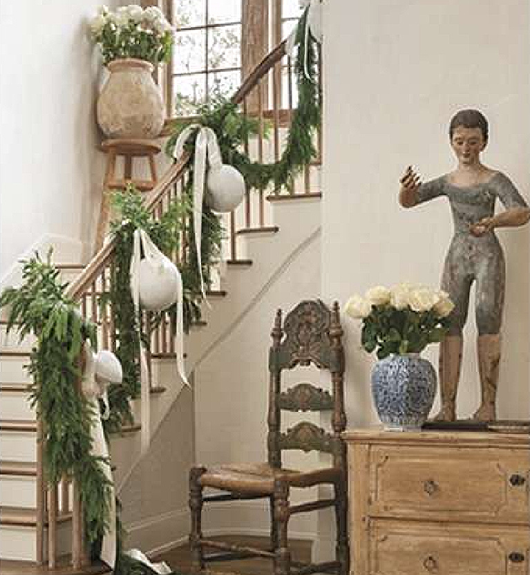 French country Christmas decorated staircase in the breathtaking Houston home of Pamela Pierce for Milieu magazine - photo by Peter Vitale.