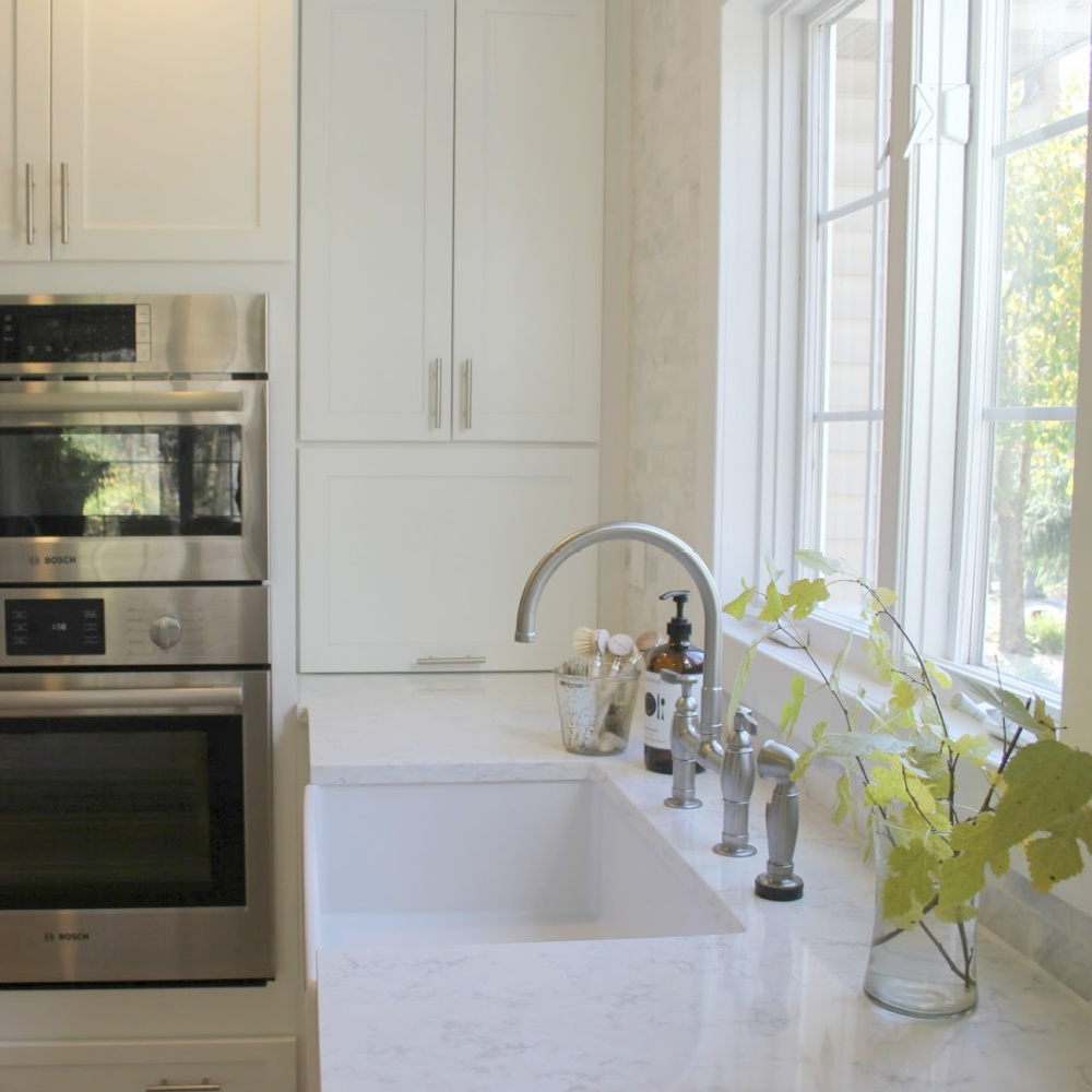 My white modern farmhouse style kitchen with Viatera Minuet quartz countertops--read more about how I arrived at this shade of white quartz for the project. #minuet #quartz #kitchendesign