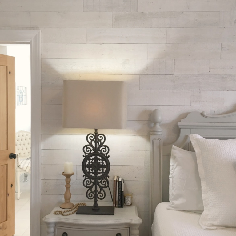 Stikwood Hamptons reclaimed pine peel and stick wood statement wall in our white French country romantic bedroom - Hello Lovely Studio. #frenchcountry #hellolovelystudio #bedroomdecor #stikwood #hamptons #shiplap #woodplank #statementwall