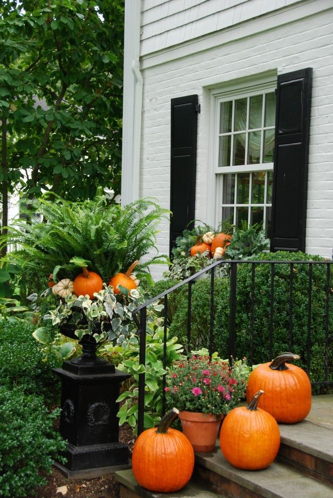 Lush greenery and pumpkins for outdoor fall decor