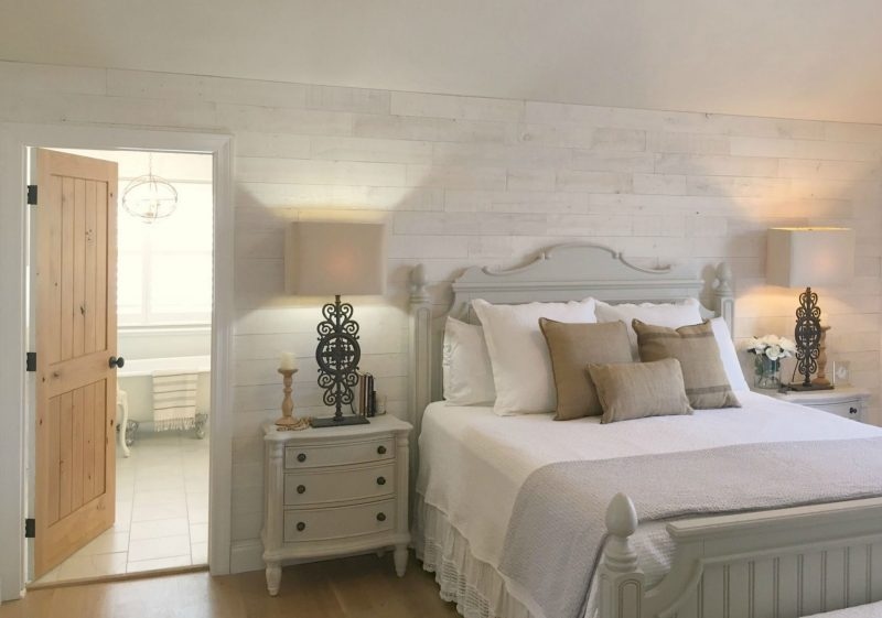 Modern farmhouse bedroom with rustic shiplap elegance by Hello Lovely Studio