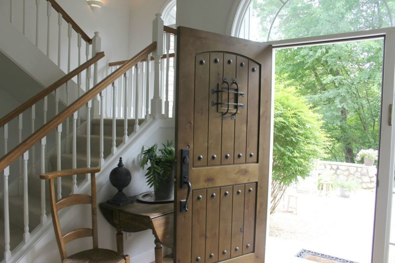 Entry way with alder front door by Hello Lovely Studio