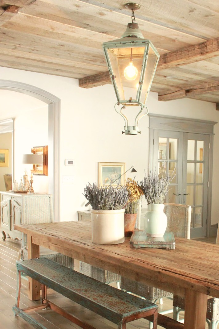 Breakfast dining area in a country French farmhouse style cottage with grey stained trim, green accents, and rustic elegance by Decor de Provence. #diningroom #Frenchfarmhouse #Frenchcountry
