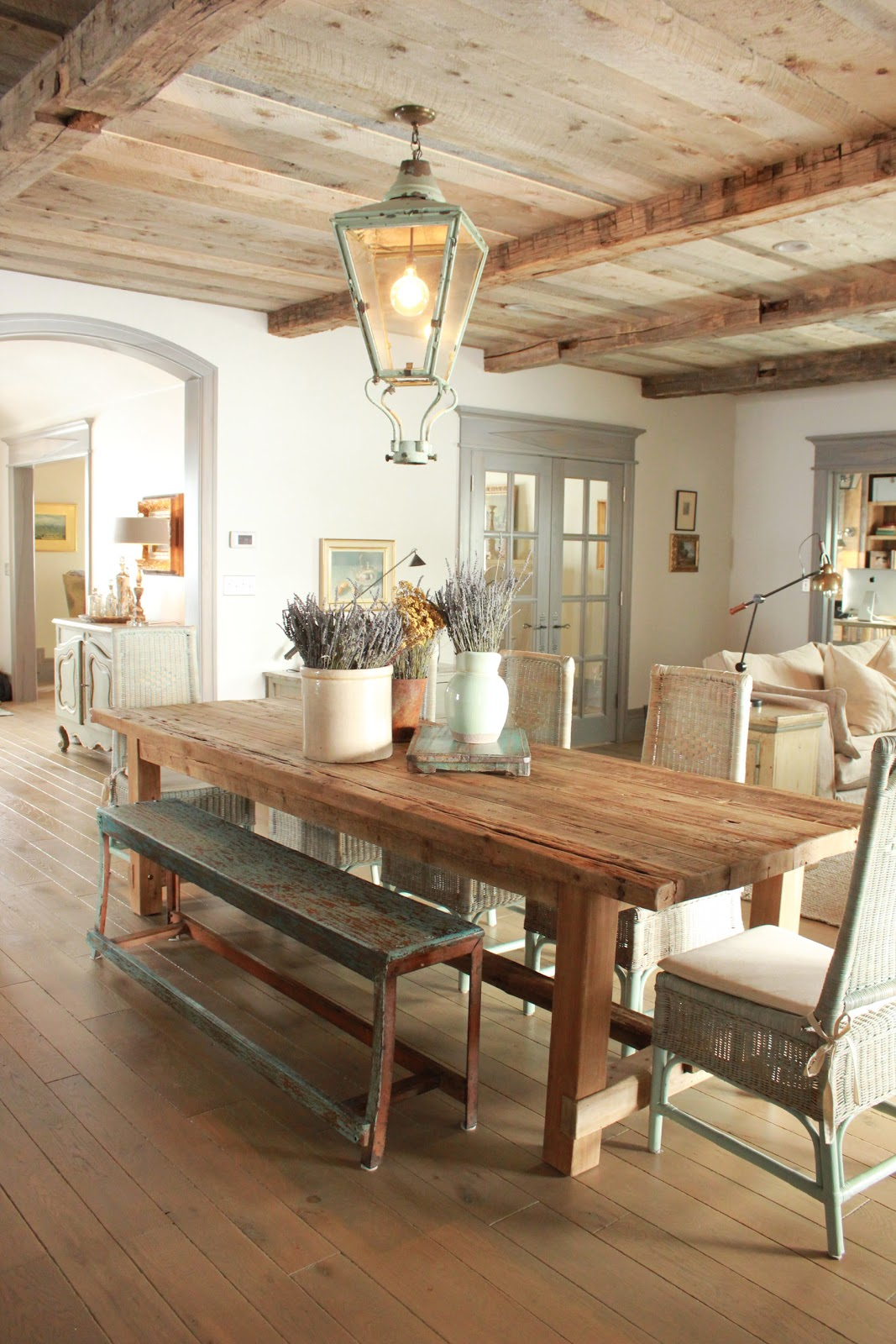 Magnificent Gustavian French dining room in stone cottage with rustic interiors, reclaimed wood ceilings, blue-grey, green, and collected European antiques. Designed by Desiree Ashworth. Find ideas for grey, blue, and green paint colors.