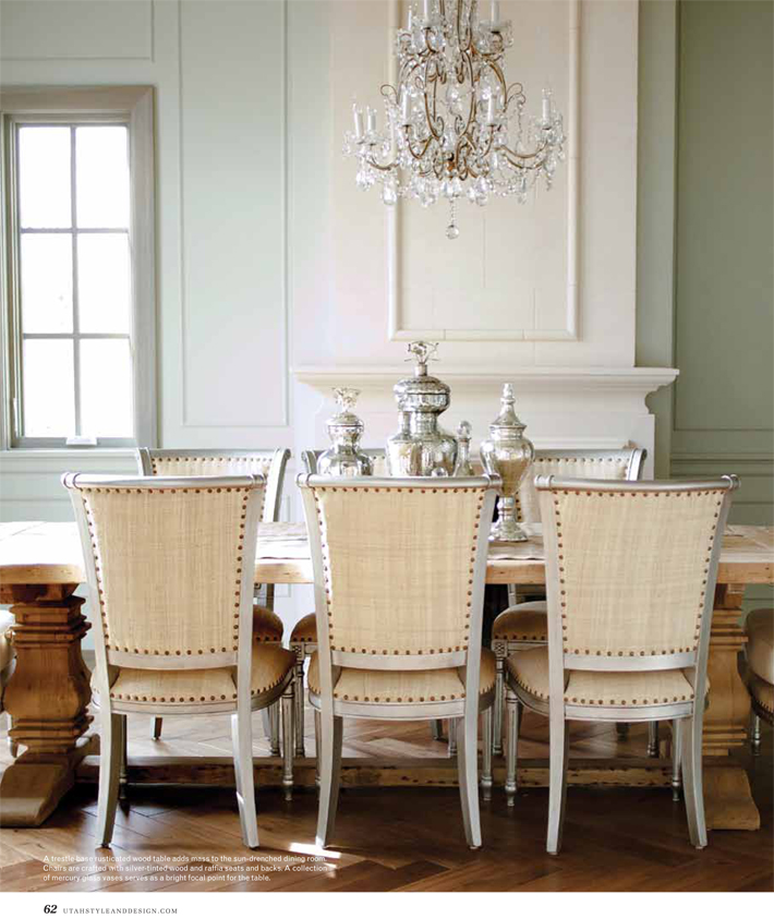 Beautifully serene and quiet dining room with French dining chairs with nailhead trim, chandelier, and stunning French fireplace. Decor de Provence. #FrenchCountry #diningroom #pedestaltable