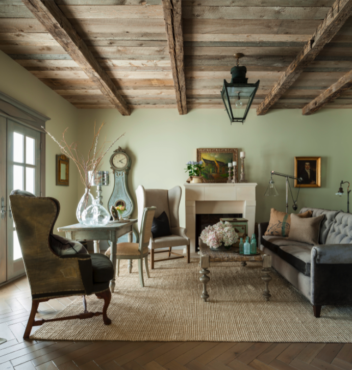 Rustic wood ceiling and aqua in a French Country style living room on Hello Lovely