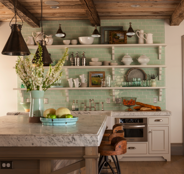 Cheerful green wubway tile backsplash, accent wall, open shelving, and rustic wood ceiling in a beautiful Old World French Country cottage kitchen by Desiree of Decor de Provence. #openshelving #cottagekitchen #cottagestyle #frenchcountry