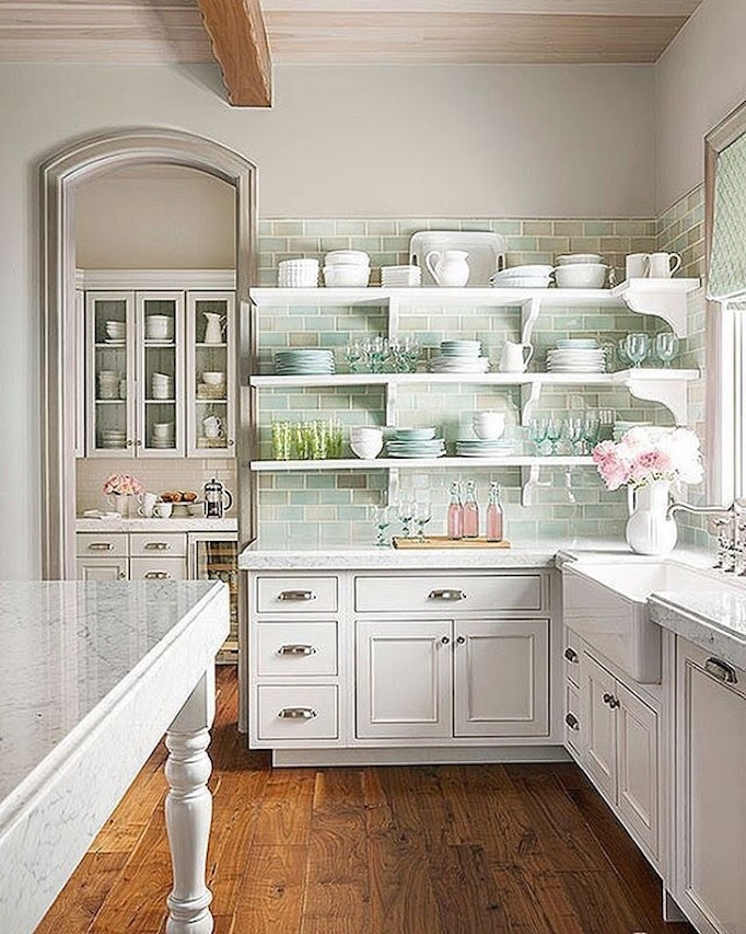 Cheerful white French Country kitchen design with soft greens and aqua blues, open shelving, and high ceilings in a stunning #FrenchCountry home by Decor de Provence. #kitchendesign #serenekitchen #Farmhousekitchen