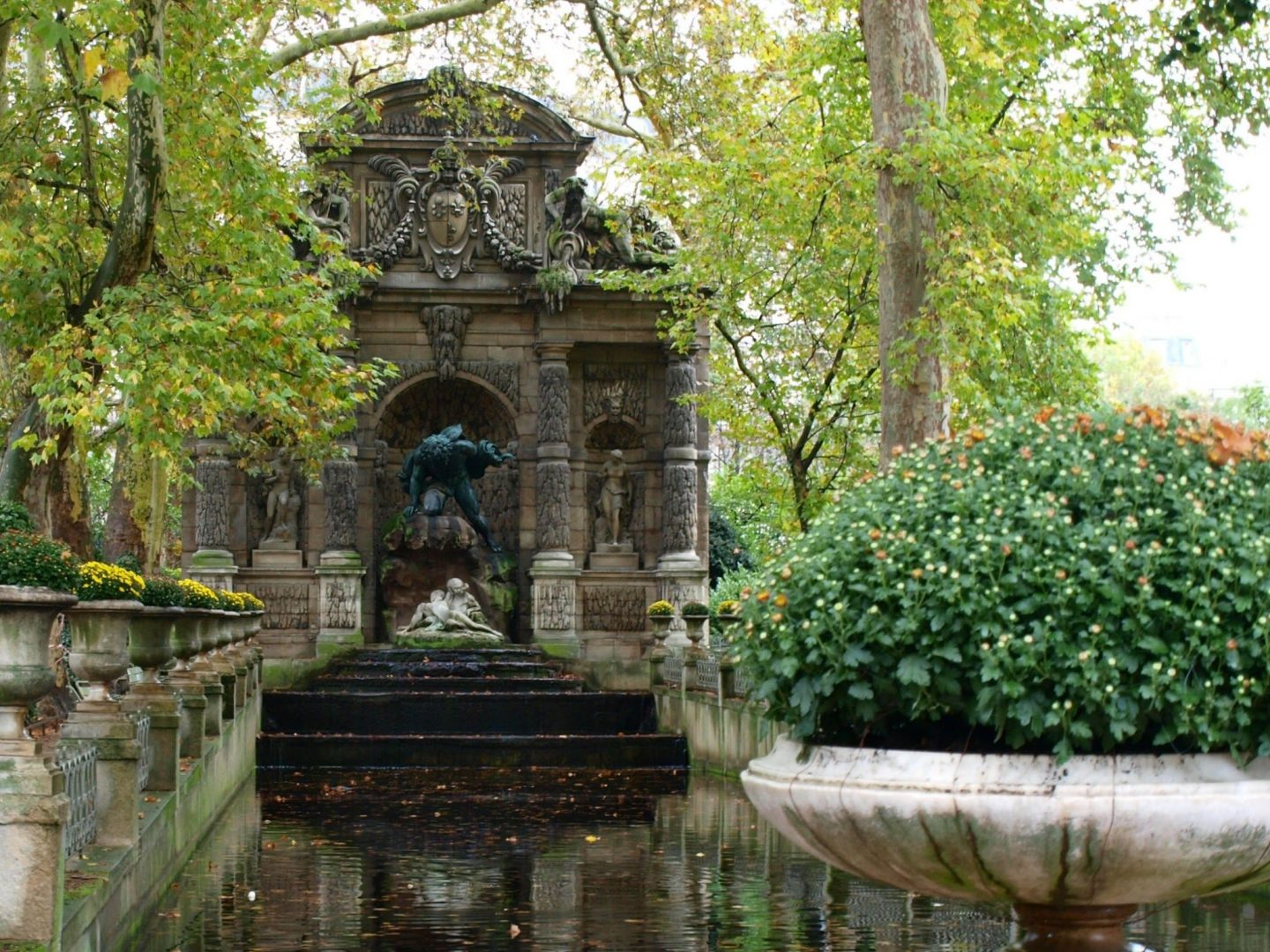 Beautiful pond at Luxembourg Gardens in Paris in fall by Hello Lovely Studio