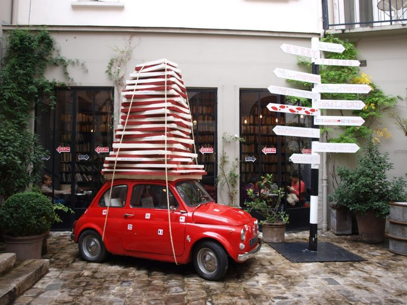 Red car outside of Merci store in Paris by Hello Lovely Studio