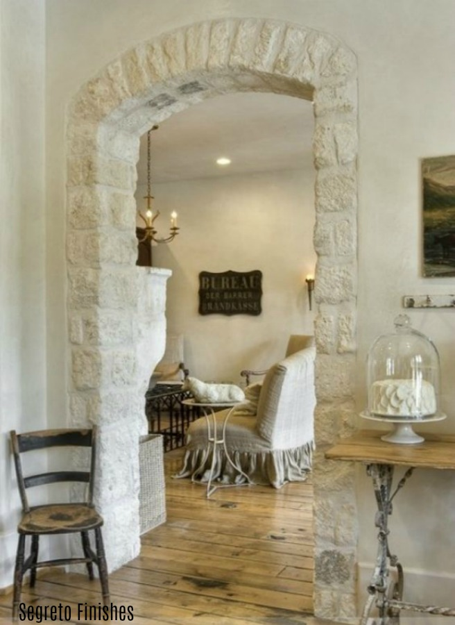 Beautiful Old World style and French farmhouse charm abound in this space with design by Sarah West and finishes by Segreto. #frenchfarmhouse #oldworld #interiordesign #rusticstone