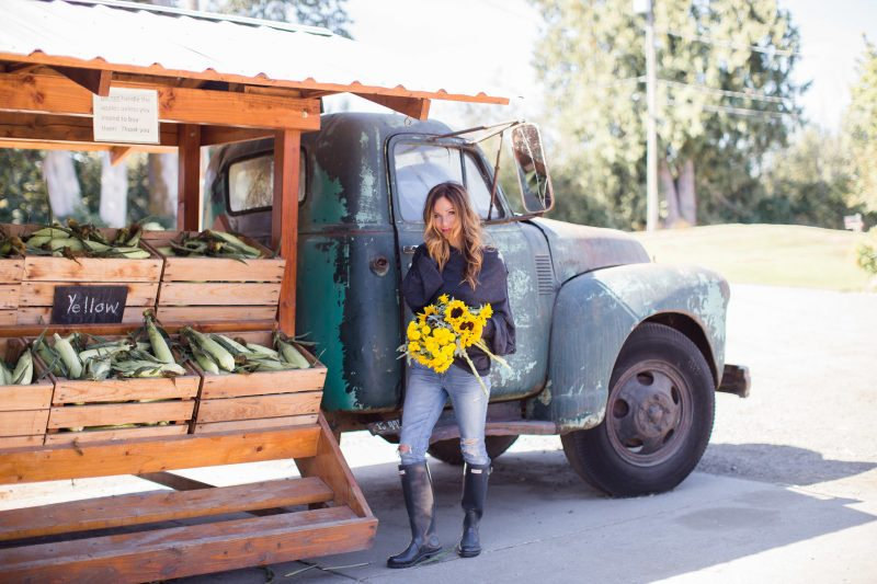 Leslie of Pretty Petals with farm truck and sunflowers