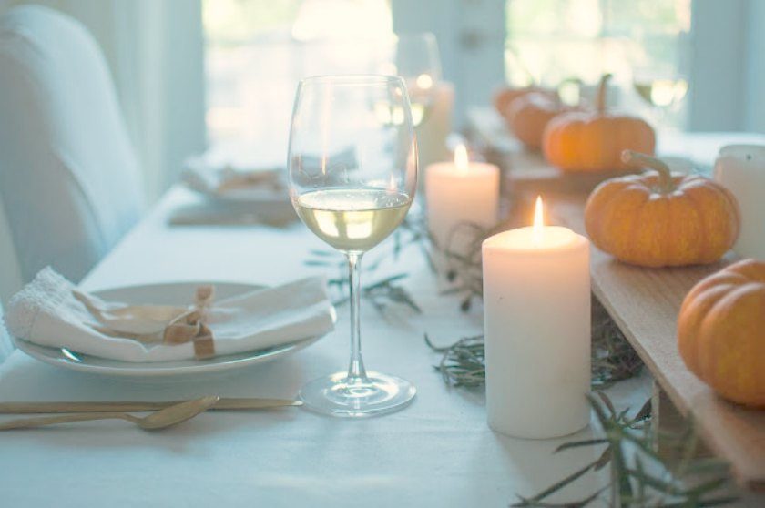 Calm and organic fall tablescape with simple pumpkins and candlelight - Gwen Moss for Hello Lovely