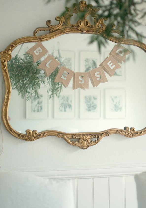 Blessed pennant banner on gilded mirror in calm dining room by Gwen Moss on Hello Lovely