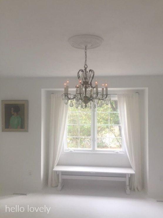White serene studio with vintage chandelier - Hello Lovely Studio