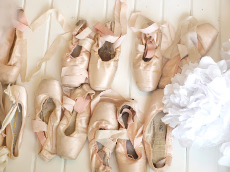 My collection of European pink dead pointe shoes in a dressing room - Hello Lovely Studio.