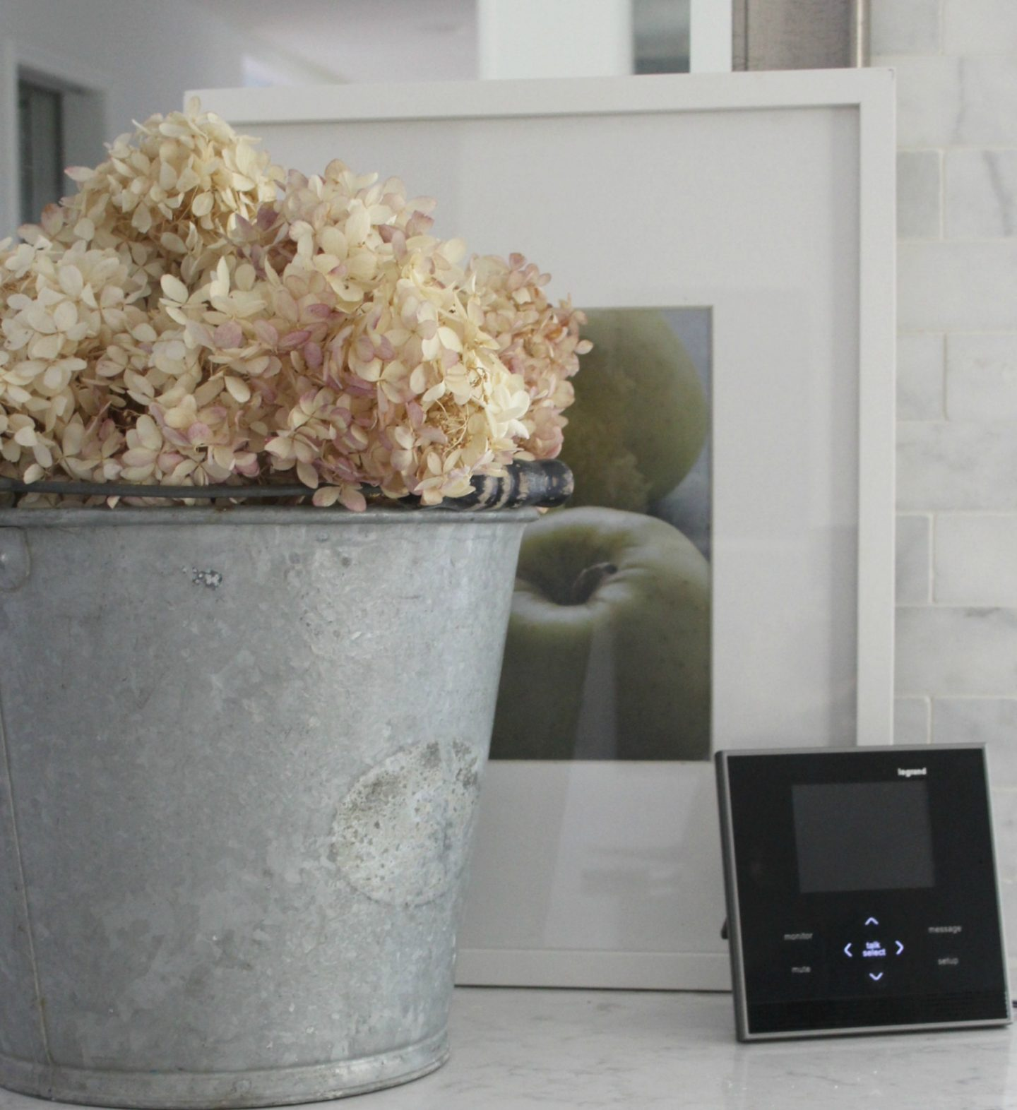 Interior intercom unit from adorne on kitchen counter with bucket of hydrangea - Hello Lovely