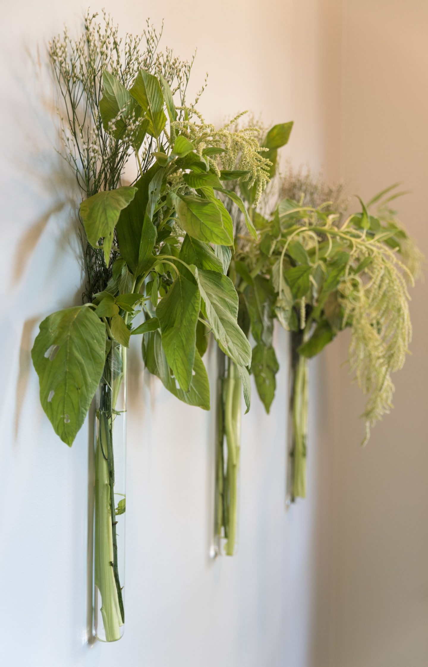 Enchanting and organic wall vases in foyer designed by Kate Ladd for O'More Show House