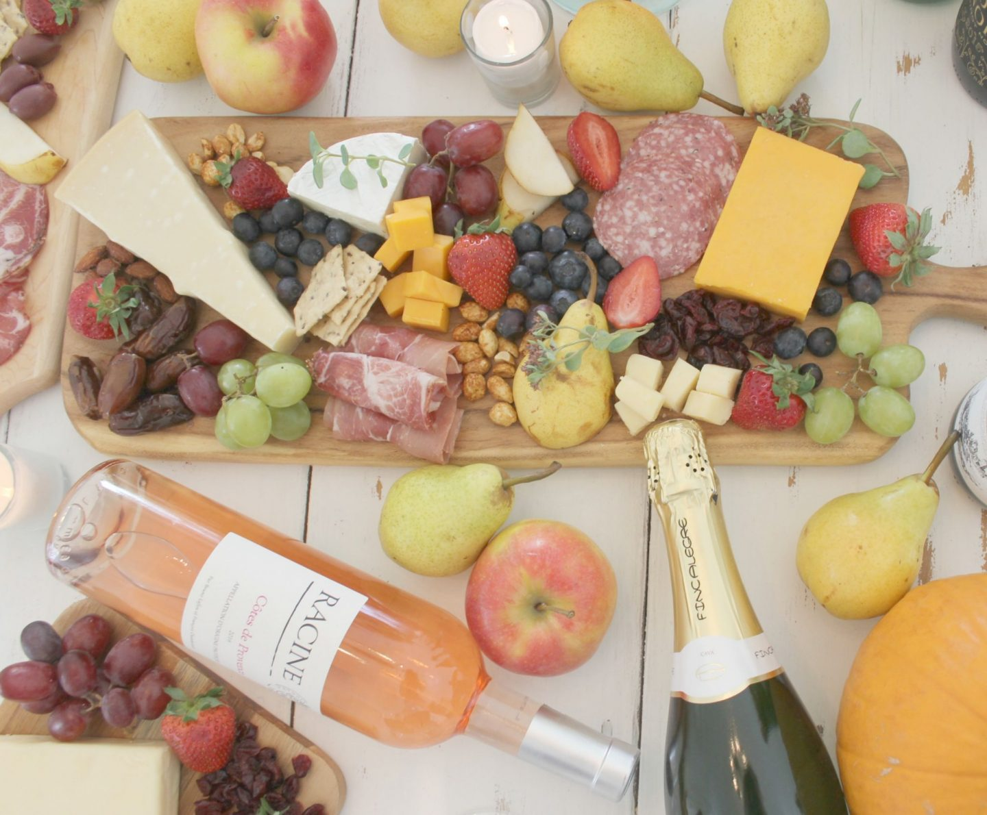 Colorful tablescape with cheese boards and wine by Hello Lovely Studio
