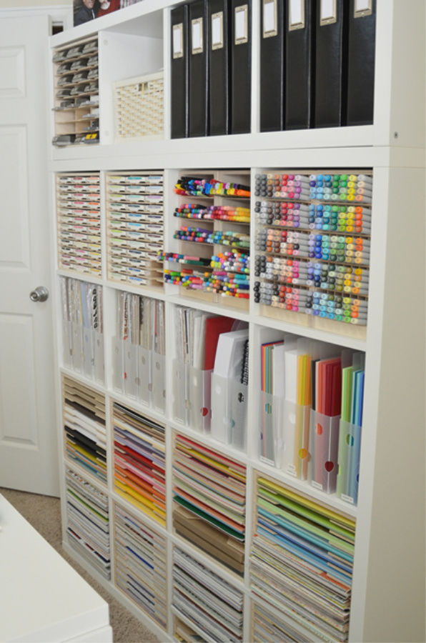 Kallax from Ikea is put to work in a craft room to store markers, paper and all sorts of supplies in a beautiful way - StampnStorage. #kallax #storage #organization #craftroom #diy #ikeahacks