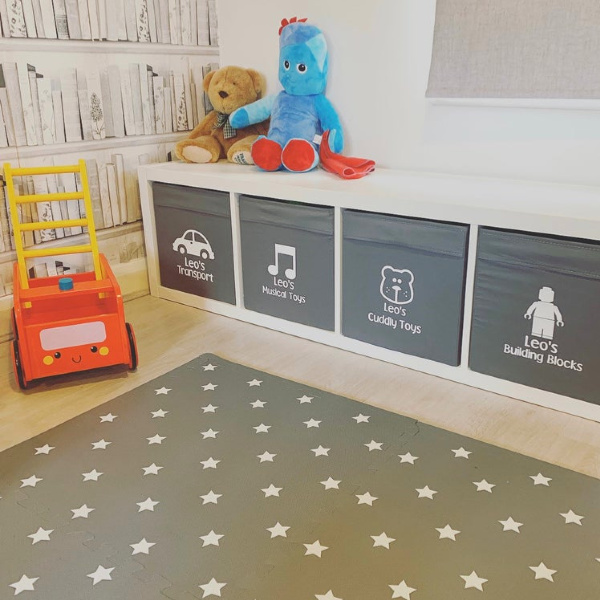 Kallax shelf hack for a kids room with custom stickers from DaisyDesignsBespoke on Etsy. #kidsroom #storage #homedecor #kallax #ikeahacks
