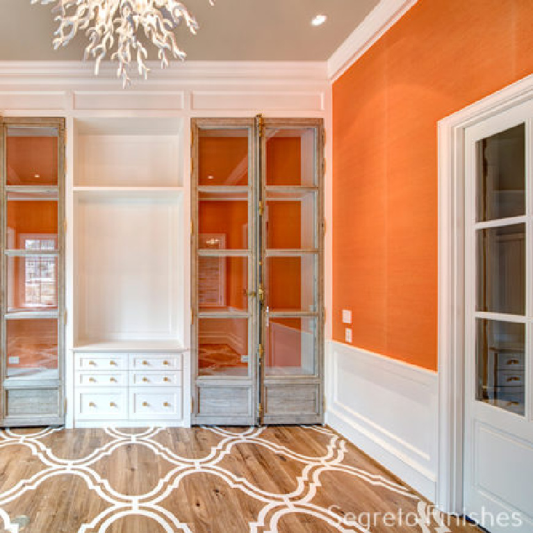 Vibrant orange walls in a space with Segreto Finishes (beautiful wall colors and plaster) in a lovely designed room in Leslie Sinclair's book. #plasterwalls #segretofinishes #orangewalls
