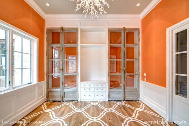 Beautiful architectural finishes in a bright orange room by Segreto Finishes
