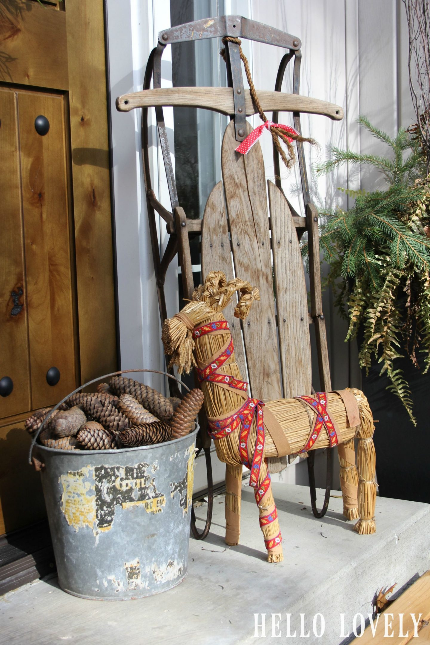 Swedish straw goat and holiday decor at my front door - Hello Lovely Studio.