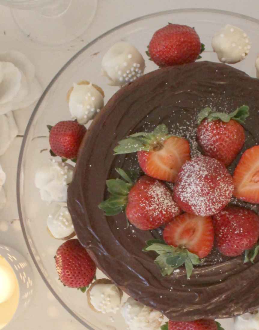 Beautiful chocolate cake with ganache icing, berries, and sugar cookie truffles by Hello Lovely Studio