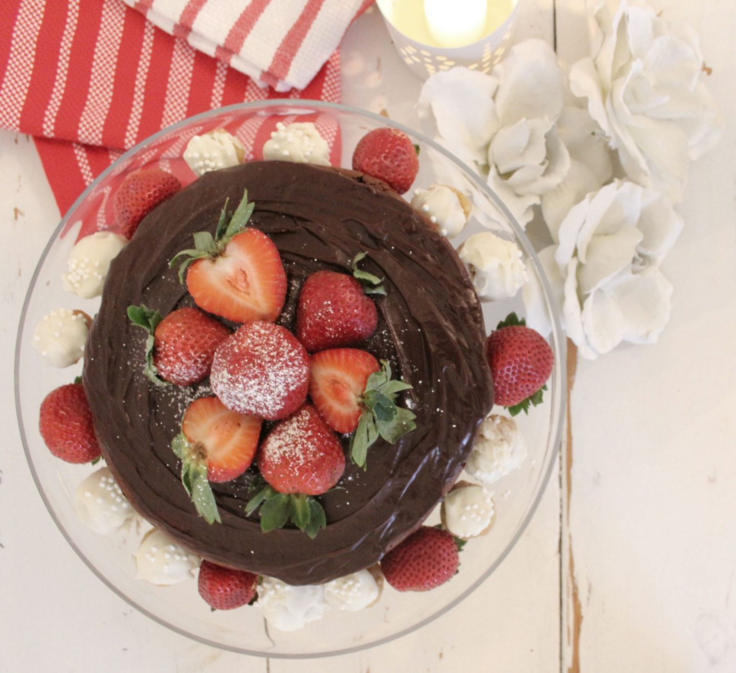 Gluten free chocolate cake topped with strawberries by Hello Lovely Studio