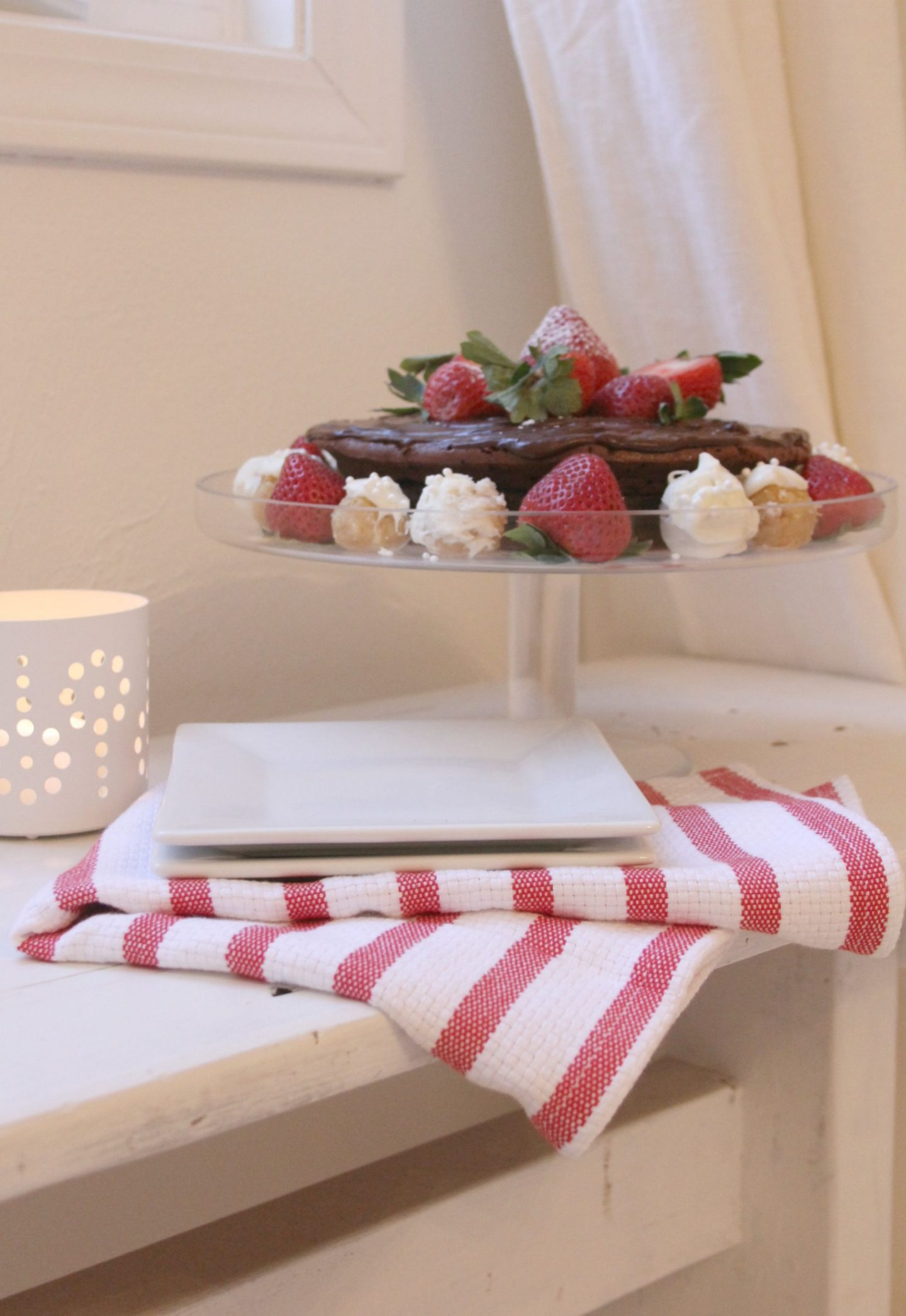 Chocolate cake with strawberries and sugar cookie truffles by Hello Lovely Studio