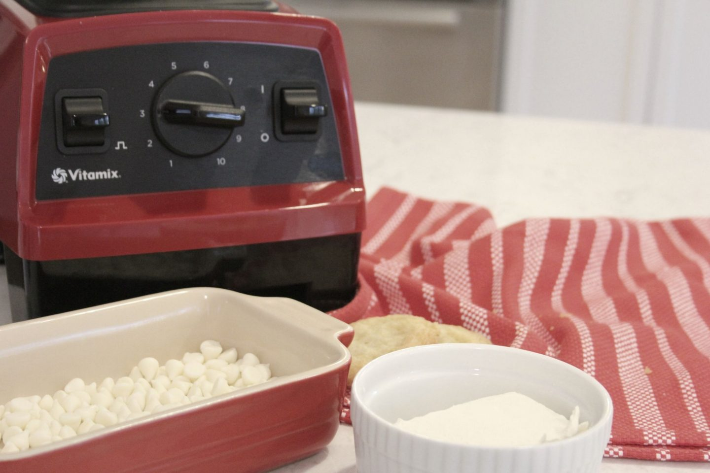 Red vitamix with ingredients for sugar cookie truffles by Hello Lovely Studio
