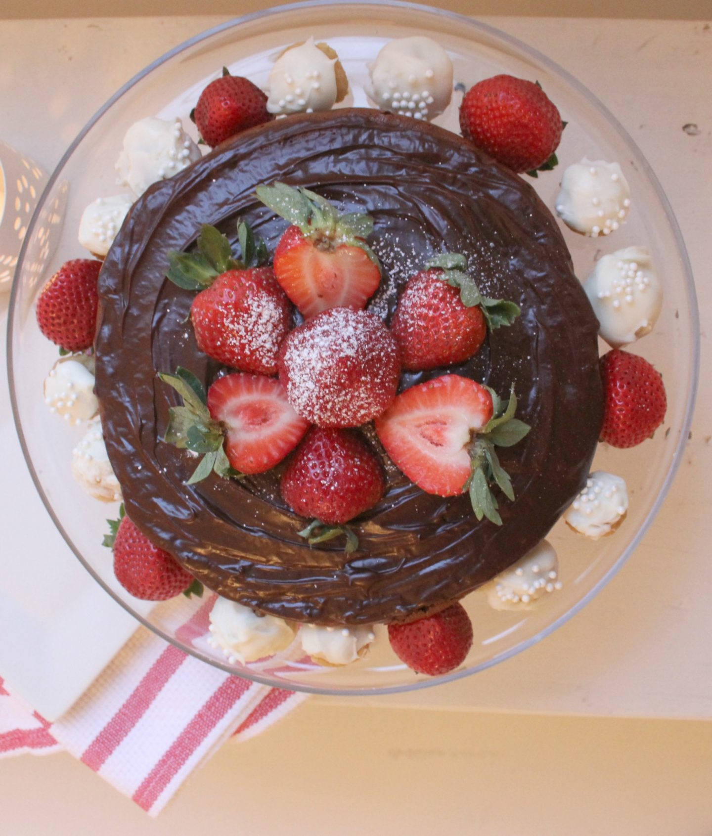 Chocolate cake with chocolate ganache, strawberries, and snowball truffles - Hello Lovely Studio