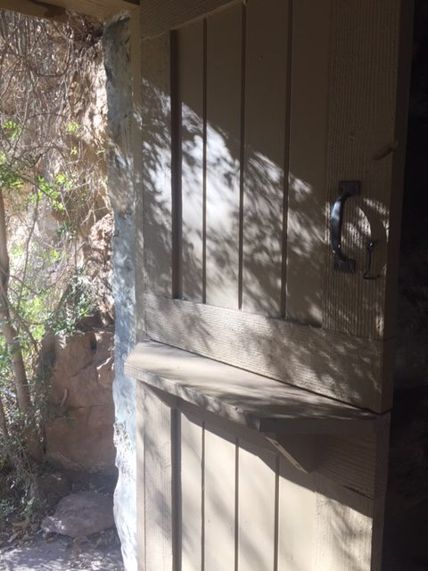 Door to a primitive structure at Boyce Thompson Arboretum in Arizona - Hello Lovely Studio.