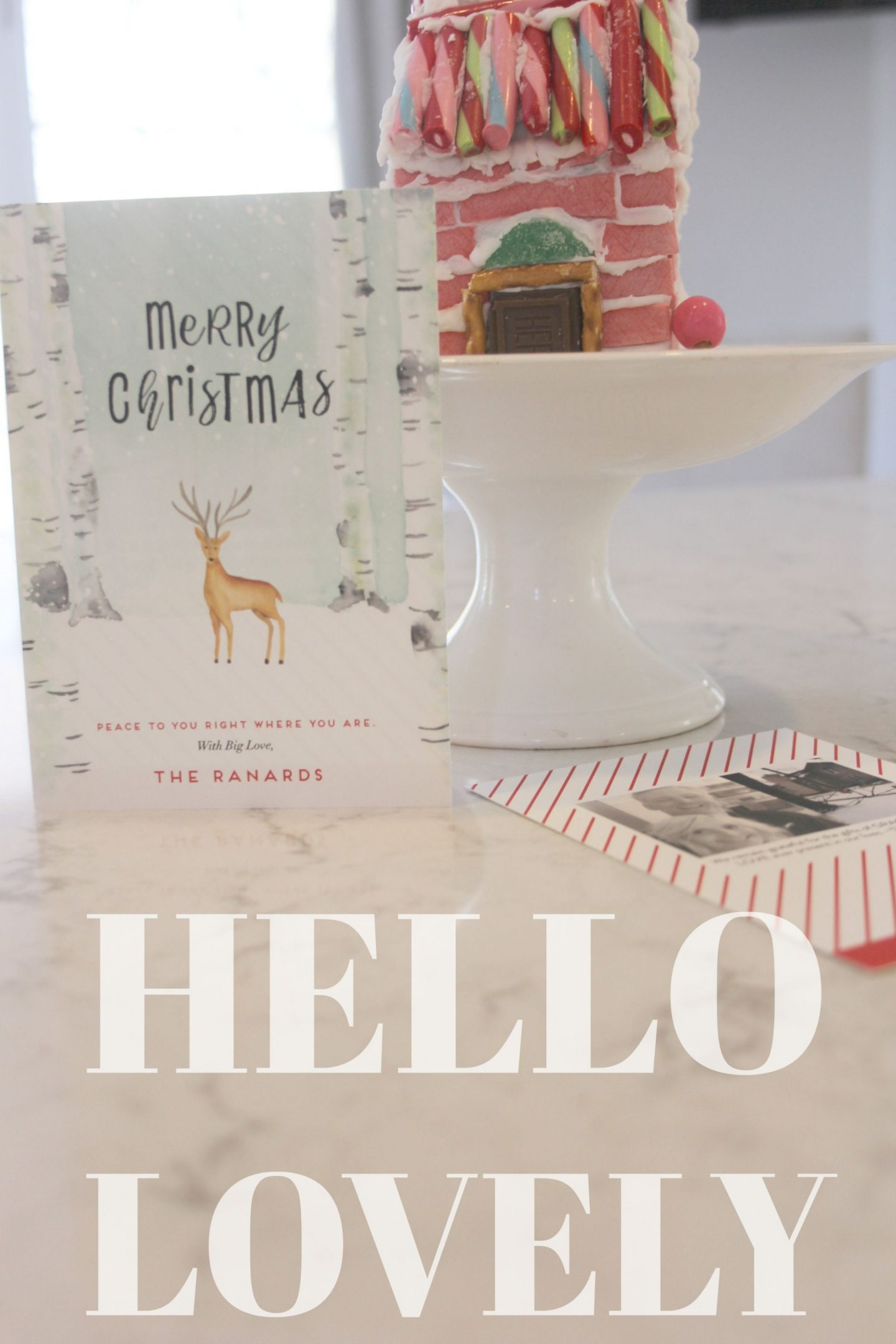 Holiday card from Minted plus my pink gingerbread house on a white pedestal - Hello Lovely Studio. COME BE INSPIRED by 7 Christmas Card Photo Hacks!