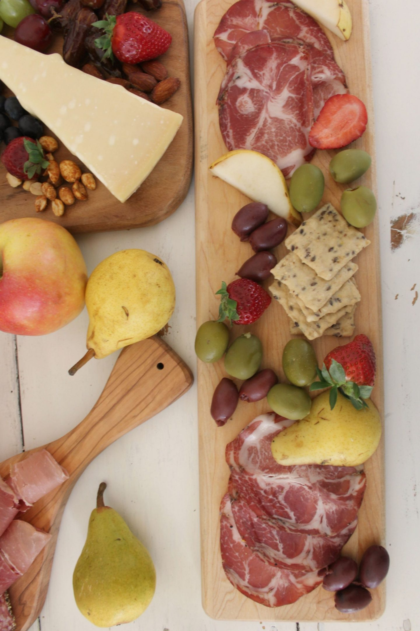 Beautiful colorful charcuterie and cheese platters with apples and pears by Hello Lovely Studio