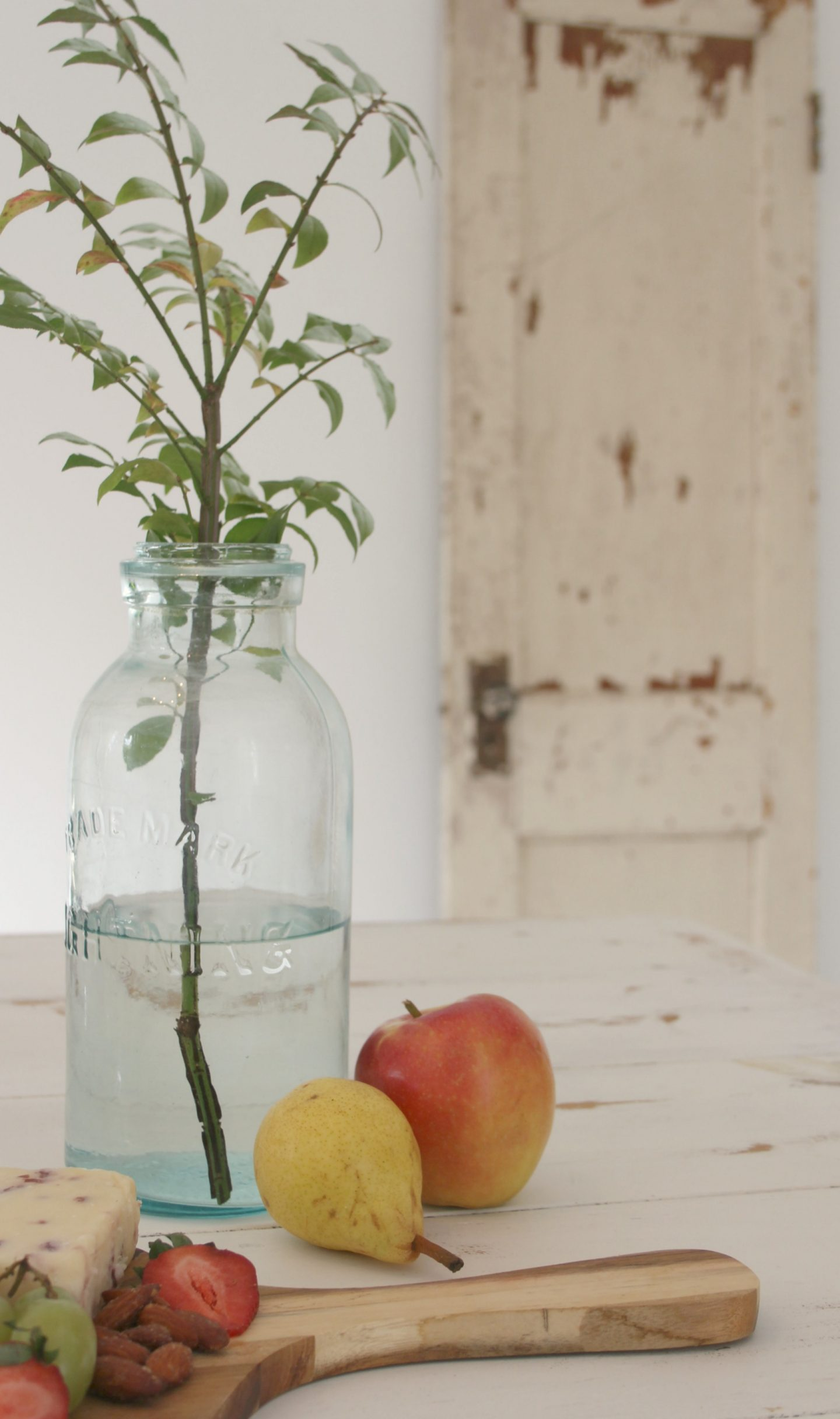 Peaceful, soft farmhouse still life with green mason jar, fruit, and a peely painted door - Hello Lovely Studio. FALL In Love With Autumn: Pre-PEAR Yourself for Yummy Pear Inspiration Ahead!