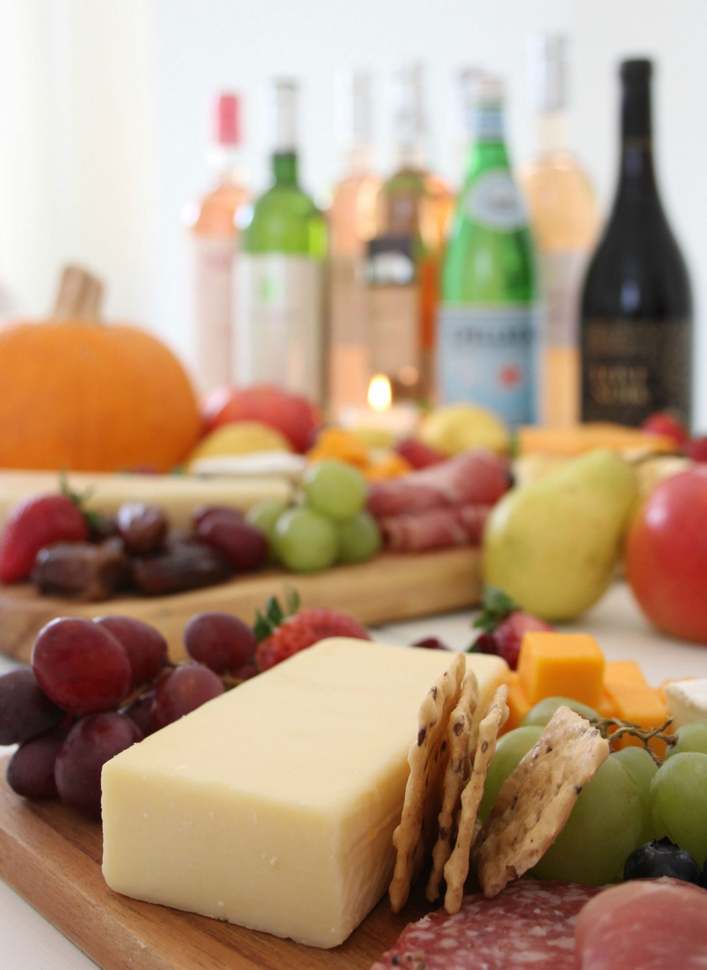 Beautiful colorful cheese boards and charcuterie platters with wine by Hello Lovely Studio