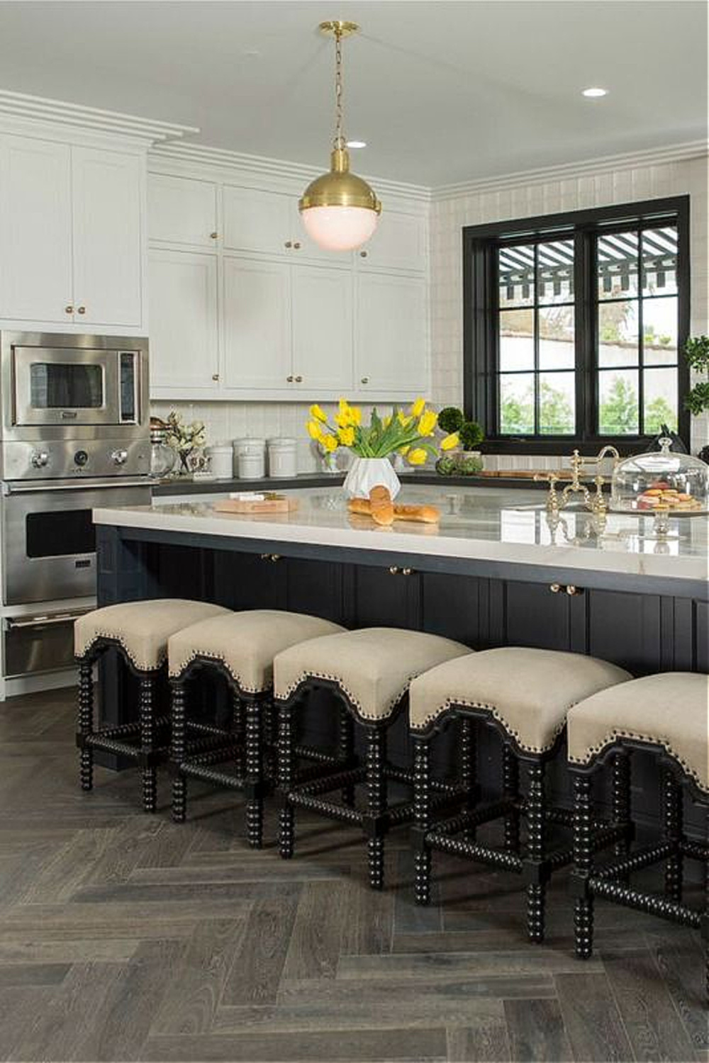Drew's honeymoon house kitchen (a classic black and white 1920s beauty!) with Farrow & Ball Railings on island and trim. #drewscott #propertybrothers #honeymoonhouse #kitchen #railings