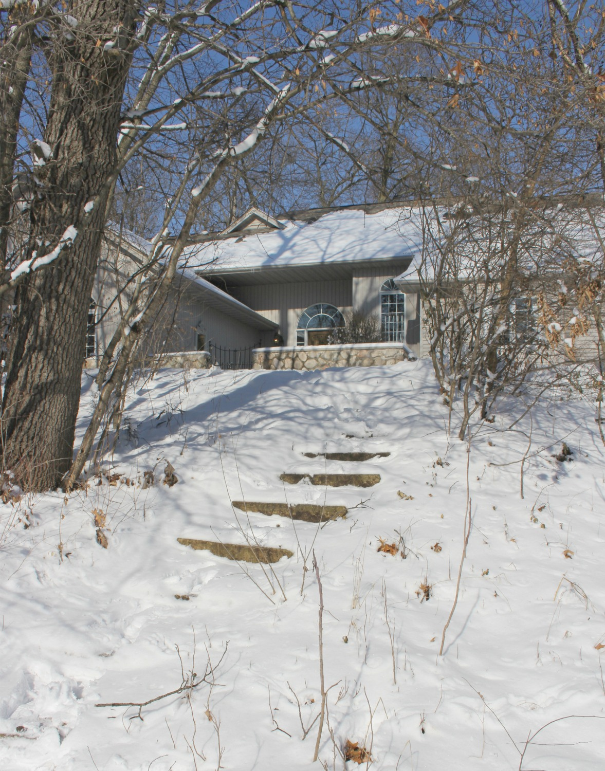 Snow covered hill in front of our home in the woods - Hello Lovely Studio.