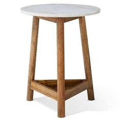 Lanham round marble top side table wood with 3 legs.