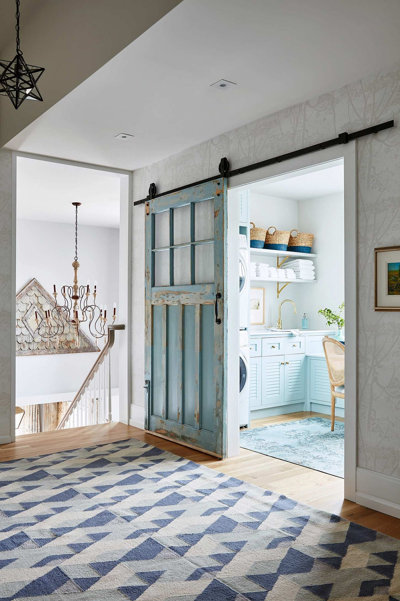 Beautiful sliding turquoise blue vintage door to laundry room in Sarah Richardson's off the grid house . #barndoor #vintagedoor #turquoise