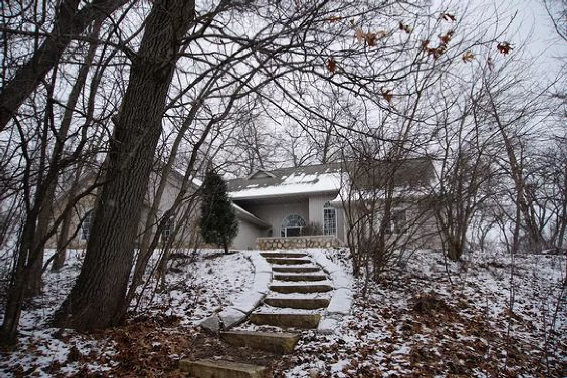 Entrance with stone steps to our home in the woods in winter - Hello Lovely Studio. #hellolovelystudio #cottageexterior