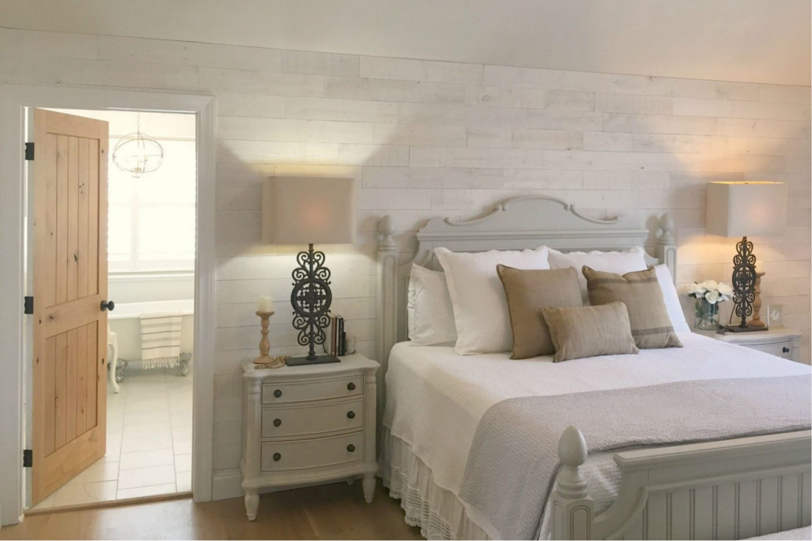 French country bedroom with cottage style furniture and rustic white Stikwood (Hamptons) wood plank wall. #hellolovelystudio #frenchcountry #bedroomdecor #stikwood #hamptons #frenchfarmhouse #allwhite #interiordesign