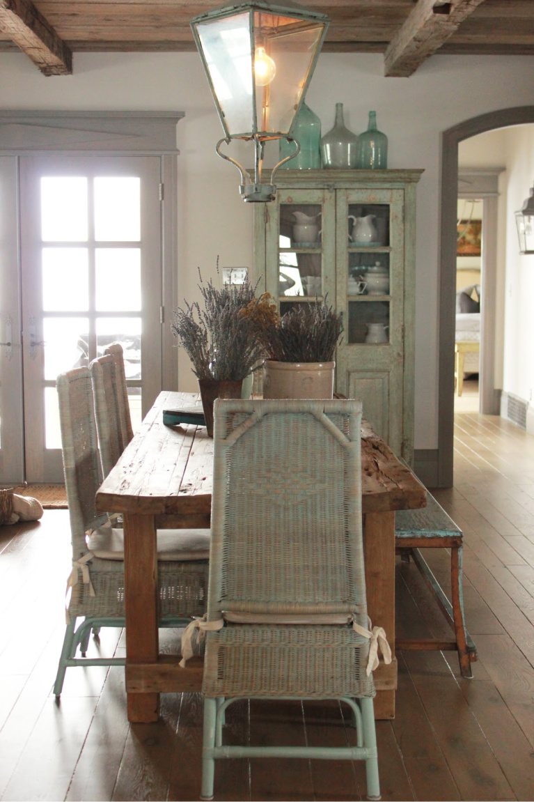 Rustic dining in Country French Old World style in a newly built custom cottage home in Utah - Score decorating ideas with blue & green from Decor de Provence. #countryfrench #interiordesign #oldworldstyle #europeancountry