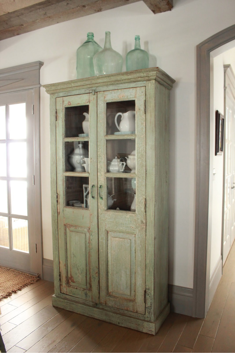 Vintage painted green cabinet in Country French Old World style in a newly built custom cottage home in Utah - Decor de Provence. #countryfrench #interiordesign #oldworldstyle #europeancountry
