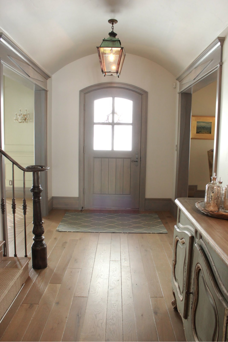 Arched front door in entry of Country French Old World style in a newly built custom cottage home in Utah - Decor de Provence. #countryfrench #interiordesign #oldworldstyle #europeancountry